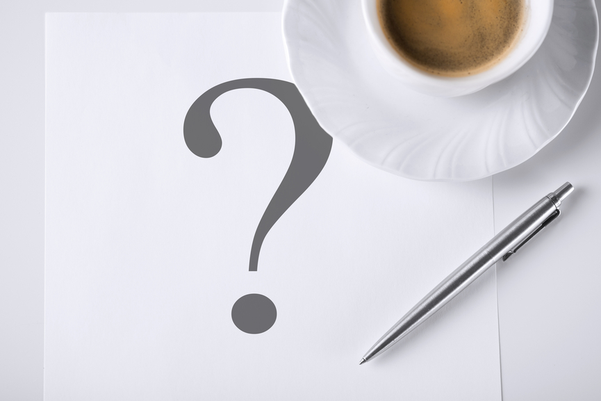 business concept - note with question mark and coffee